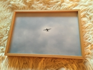 Airplane on a grey sky